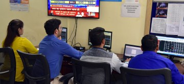 Bikaner: Stock brokers keep a close eye on share prices, in Bikaner on July 8, 2019. Disappointment over the Budget proposals and muted global markets led the Sensex to log the heaviest fall in seven months on Monday. Both the key equity indices -- Sensex and Nifty -- fell over 2 per cent. The 30-scrip Sensex closed 792.82 points or 2.01 per cent lower at 38,720.57 and the broader Nifty50 declined by 252.55 points or 2.14 per cent to 11,558.60. (Photo: IANS)