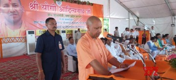 Sonebhadra: Uttar Pradesh Chief Minister Yogi Adityanath addresses during a programme where he handed over land documents to 281 local residents, in Uttar Pradesh's Sonebhadra district, where 11 tribals had been killed on July 17 in a land dispute; on Sep 13, 2019. Adityanath gave allotment of lease of a total 852 bigha of land to 281 beneficiaries, mostly tribals. He also gifted developmental projects worth Rs 339.80 crore to the district laying the foundation of 11 schemes and inaugurating 35 projects. (Photo: IANS)