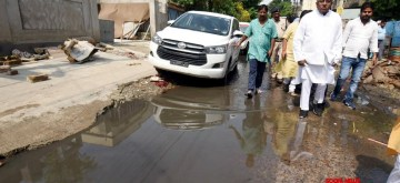 Patna: Union Minister Ravi Shankar Prasad takes stock of the situation of water accumulation on roads with potholes amidst fears of Dengue fever outbreak in Bihar; in Patna on Oct 9, 2019. (Photo: IANS)Union Minister Ravi Shankar Prasad takes stock of the situation of water accumulation on roads with potholes amidst fears of Dengue fever outbreak in Bihar; in Patna on Oct 9, 2019. (Photo: IANS)