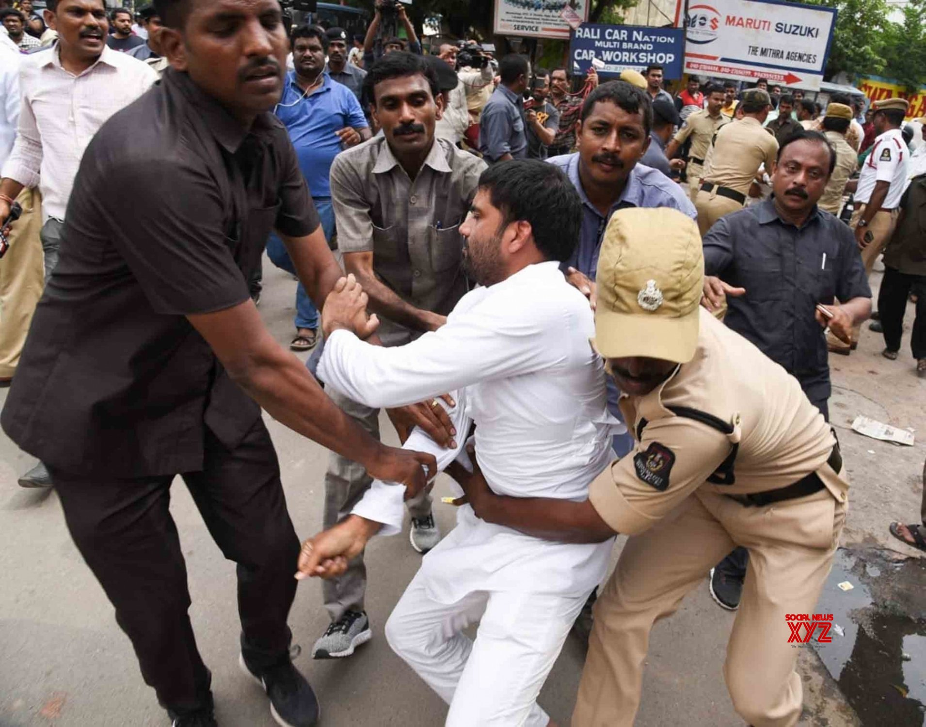 Hyderabad: Congress workers protest at Bus Bhavan, detained #Gallery