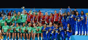 DOHA, Oct. 17, 2019 (Xinhua) -- Gold medalist players of Denmark (in red), silver medalist players of Hungary (in green) and bronze medalist players of Brazil (in blue) celebrate during the awarding ceremony of the women's beach handball at the 1st ANOC World Beach Games Qatar 2019 in Doha, capital of Qatar, on Oct. 16, 2019. (Photo by Nikku/Xinhua/IANS)