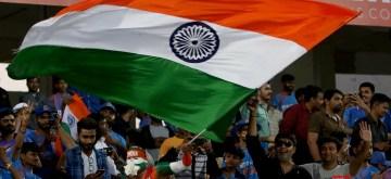 Rajkot: Indian cricket team fan Sudhir Kumar Chaudhary waves the national flag ahead of the 2nd T20I match between India and Bangladesh at Saurashtra Cricket Association Stadium in Rajkot on Nov 7, 2019. (Photo: Surjeet Yadav/IANS)