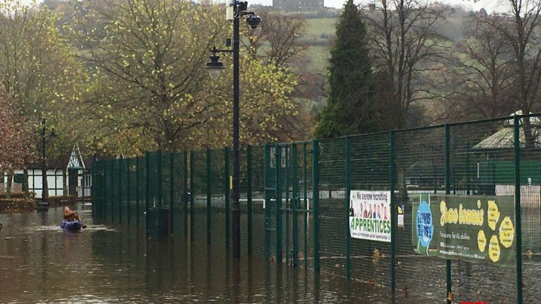 UK floods: Woman's body found after being 'swept away'