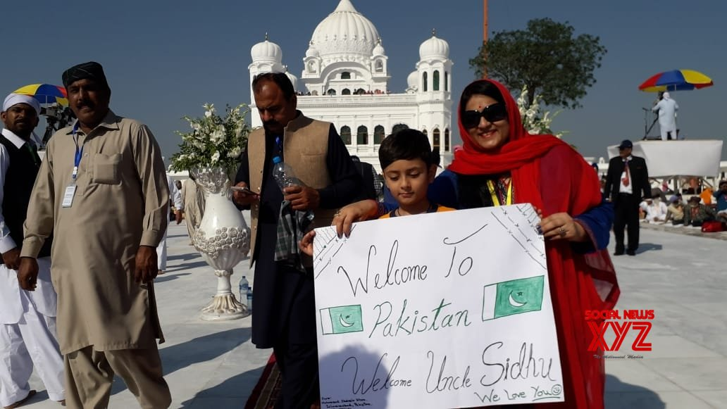 Kartarpur: Young devotee displays welcome note for Sidhu at Kartarpur Sahib in Pakistan #Gallery