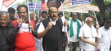 New Delhi: MDMK chief Vaiko with his party activists protest against Sri Lankan President's visit in New Delhi on Nov. 28, 2019. (Photo: IANS)