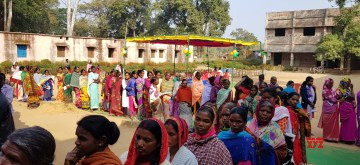 Latehar: Voters queue up outside a polling station to cast their votes for the first phase of Jharkhand Assembly elections, in Lohardaga on Nov 30, 2019. (Photo: IANS/PIB)