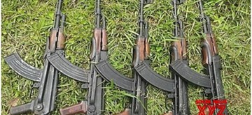 Aizawl: The AK-56 rifles that were recently seized by Assam Rifles troopers along with loaded magazines and ammunition between Farkawn and Vaphai villages in Mizoram adjoining Myanmar. These weapons were likely to be traded to Manipur-based insurgent groups. (Photo: IANS)