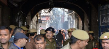 New Delhi: Police personnel stand guard outside the factory area in the Anaj Mandi area of Delhi's Rani Jhansi Road area where fire broke out, in Delhi on Dec 8, 2019. Reportedly 43 people were killed and over a dozen others injured. So far, more than 60 people have been rescued and shifted to the Lok Nayak Jai Prakash Narayan Hospital (LNJP) and Lady Harding Hospital. (Photo: IANS)