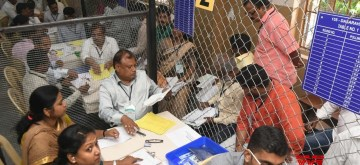 Bengaluru: Polling officials busy counting votes cast during 2019 Lok Sabha elections, at a counting center in Bengaluru on May 23, 2019. (Photo: IANS)
