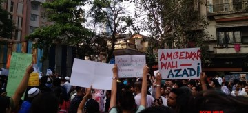 Mumbai: Protesters take to streets as they stage a demonstration against the Citizenship Amendment Act (CAA) 2019 and National Register of Citizens (NRC) in Mumbai on Dec 19, 2019. (Photo: IANS)