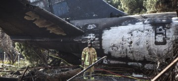 (190114) -- KARAJ, Jan. 14, 2019 (Xinhua) -- A rescuer works at the crash site of a Boeing 707 plane in Karaj, Iran, Jan. 14, 2019. At least 15 people were killed on Monday in the crash. (Xinhua/Ahmad Halabisaz)