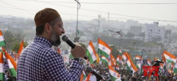 Hyderabad: AIMIM President Asaduddin Owaisi addresses a gathering of protesters during the 'Tiranga rally' organised to protest against the Citizenship Amendment Act (CAA) 2019, in Hyderabad on Jan 10, 2020. (Photo: IANS)