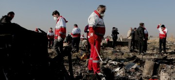 TEHRAN, Jan. 8, 2020 (Xinhua) -- Rescuers work at the air crash site of a Boeing 737 Ukrainian passenger plane in Parand district, southern Tehran, Iran, on Jan. 8, 2020. All the 179 passengers and crew members on board the Boeing 737 Ukrainian passenger plane that crashed near Tehran Imam Khomeini International Airport (IKA) on Wednesday morning were confirmed dead, Iran's Press TV reported. (Photo by Ahmad Halabisaz/Xinhua/IANS)
