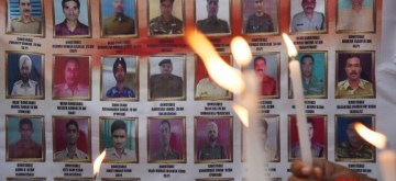 Patna: People pay tributes to the 40 CRPF soldiers who were martyred in a terror blast in Kashmir's Pulwama on this day a year ago, in Patna on Feb 14, 2020. (Photo: IANS)