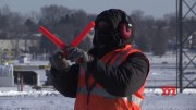 Airport worker stays positive in Midwest cold snap (Video)