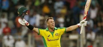 Mumbai: Australia's David Warner celebrates his century during the first ODI between India and Australia at the Wankhede Stadium in Mumbai on Jan 14, 2020. (Photo: Surjeet Yadav/IANS)