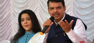 Mumbai: Maharashtra Chief Minister Devendra Fadnavis accompanied by his wife Amruta Fadnavis, addresses at a programme organised to celebrate Diwali in Mumbai on Nov 5, 2018. (Photo: IANS)
