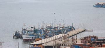 North Goa: Fishing trawlers remain anchored to a jetty on River Mandovi during a complete lockdown for 21 days announced by Prime Minister Narendra Modi to prevent further spreading of the COVID 19 pandemic in India; towards Betim in Bardez taluka of North Goa on March 25, 2020. (Phto: IANS)