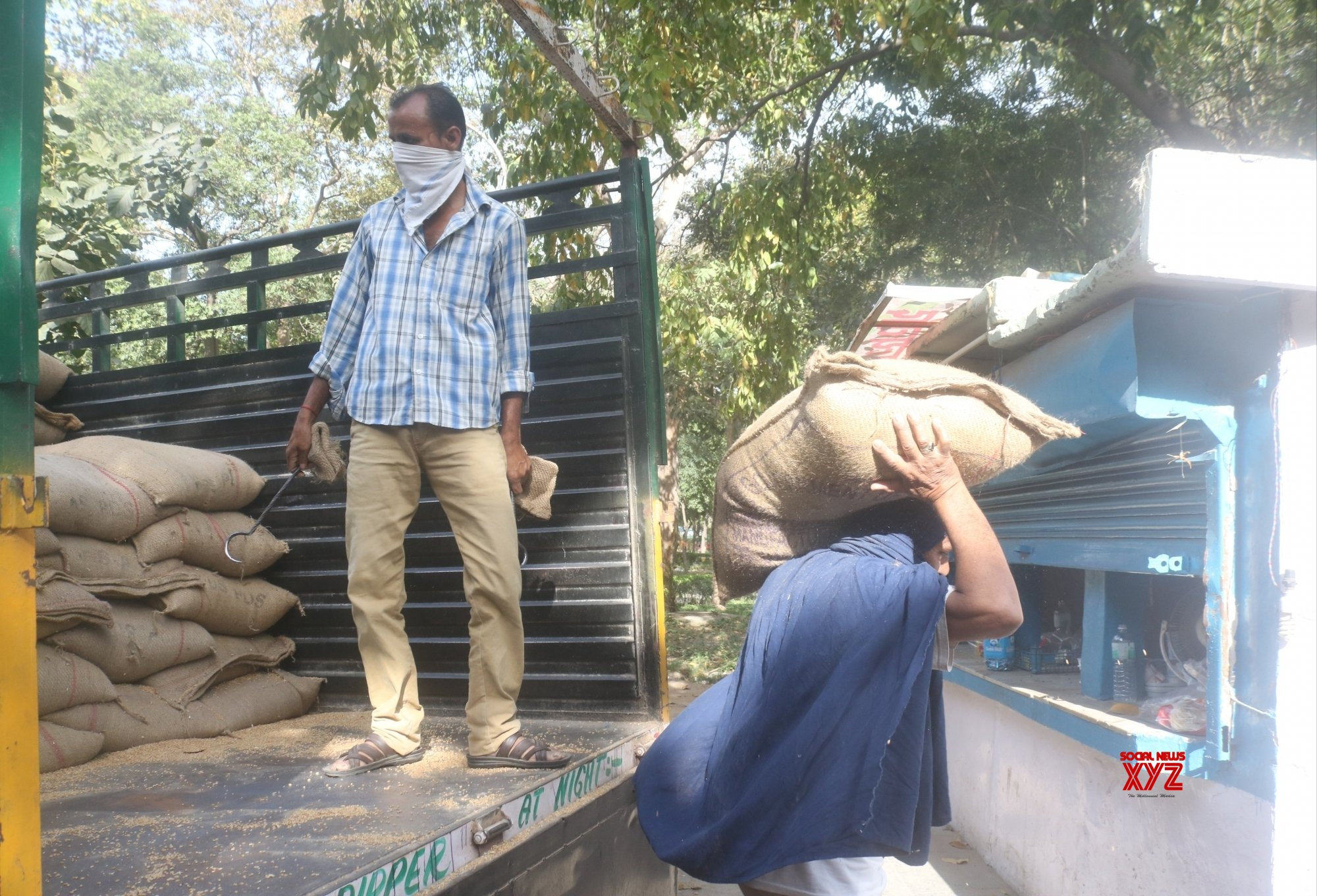 New Delhi: Wheatgrains being stored at ration shops during 21 - day lockdown #Gallery