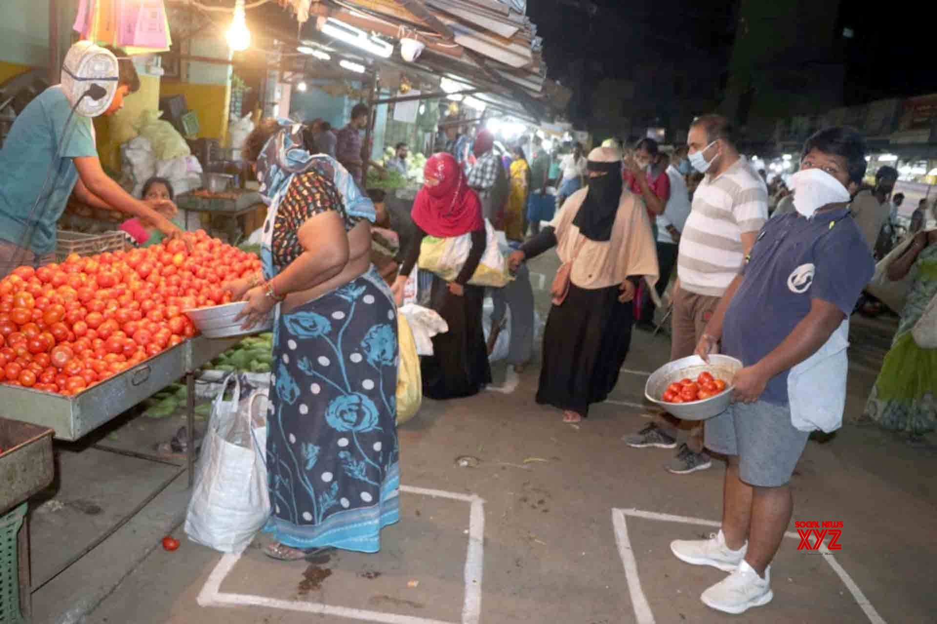 Tirupati: People practise social deitancing while shopping for essentials amid COVID - 19 pandemic #Gallery