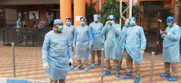 Hyderabad: Police personnel wearing protective gear deployed outside Hyderabad's Gandhi Hospital where doctors were allegedly attacked after a patient with multiple illnesses died of COVID-19, on Apr 3, 2020. (Photo: IANS)