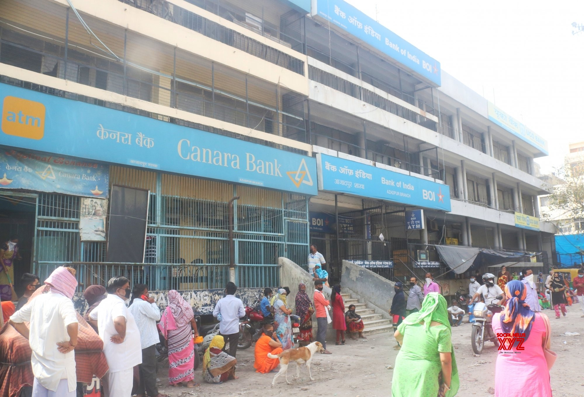 New Delhi: People waiting outside Canara Bank during extended nationwide lockdown #Gallery