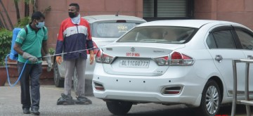 New Delhi: Vehicles of Government employees at Delhi's Rail Bhavan being sanitised during the extended nationwide lockdown imposed to mitigate the spread of coronavirus; on Apr 23, 2020. (Photo: IANS)