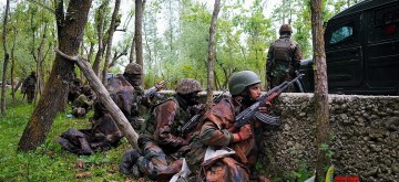Kupwara: Security personnel take position during a cordon and search operation after an encounter between holed up terrorists and the security forces in the Chanjimulla village of Handwara tehsil in Jammu and Kashmir's Kupwara district on May 3, 2020. Seven including two senior Army officers, two junior ranks, an officer of the local police and two terrorists were killed in the fierce gunbattle on Sunday. Two terrorists have also been killed in this encounter whose exact identity is being established. Although firing has stopped at the encounter site, but searches are going on there. (Photo: IANS)