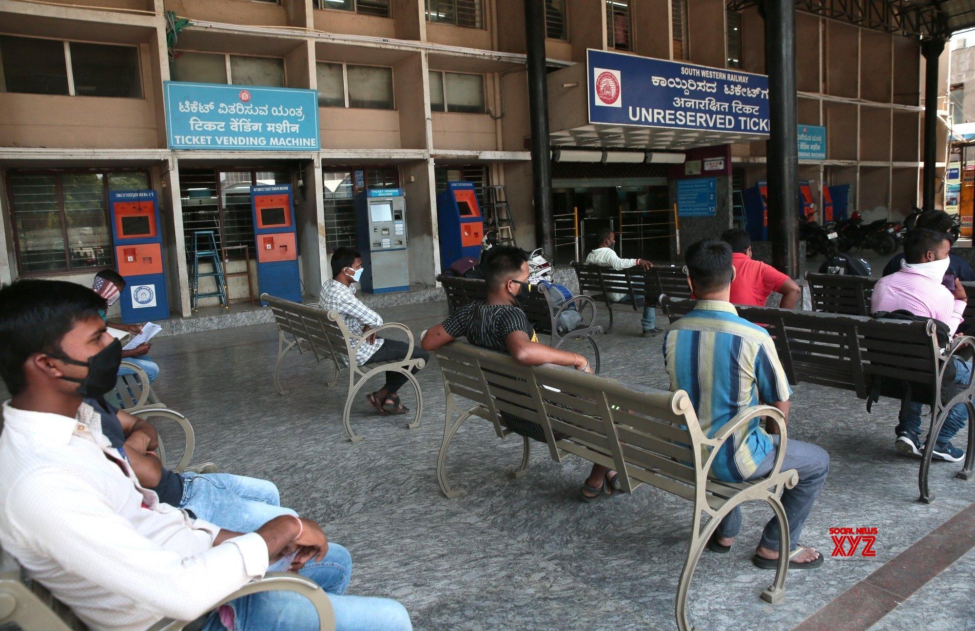 Bengaluru: - Passengers waiting at Bengaluru Railway Station #Gallery