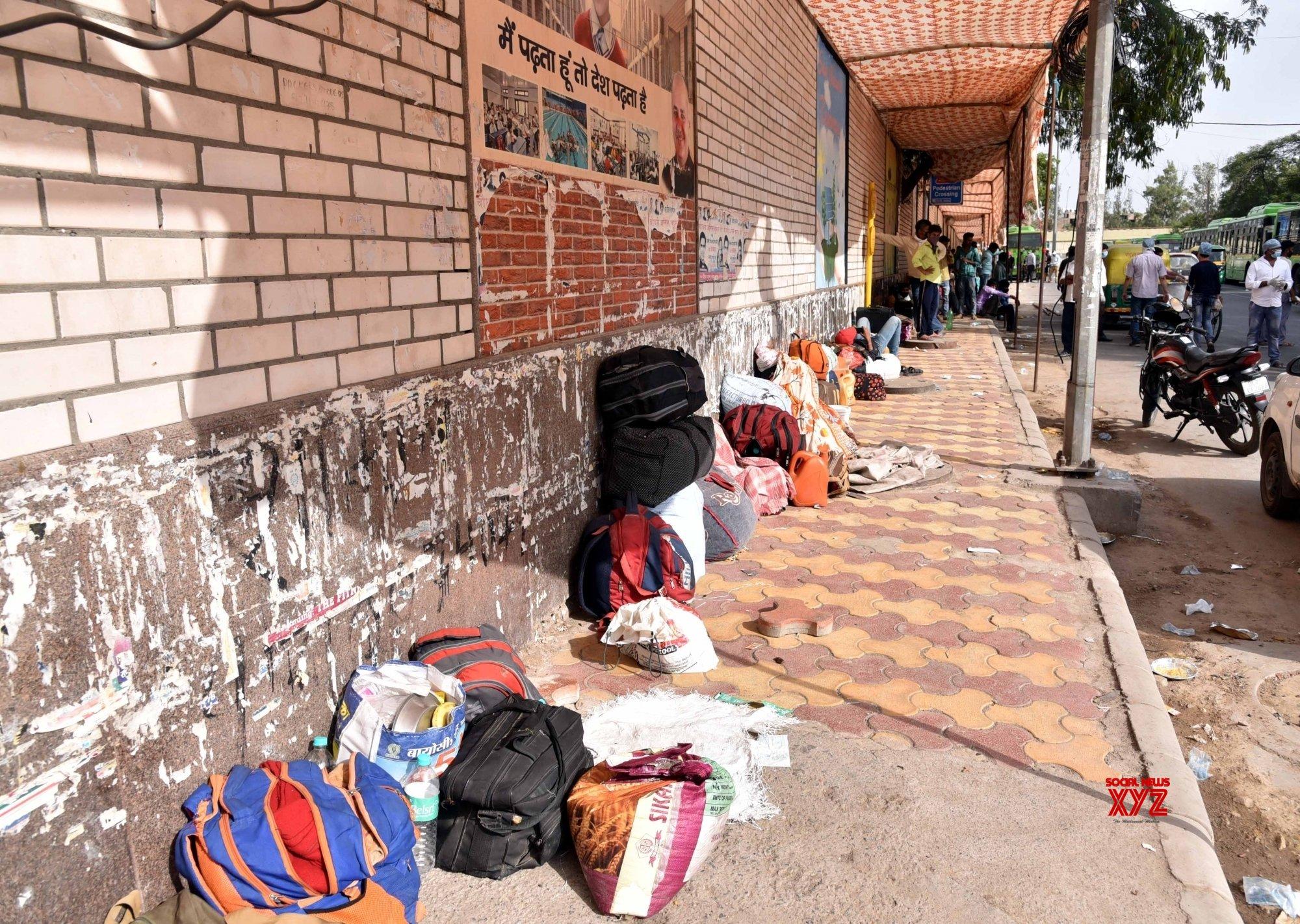 New Delhi: Migrant workers heading home gather at East Vinod Nagar school for medical screening #Gallery