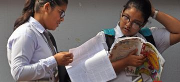 Kolkata: Students busy in last minute revision outside their exam center ahead of appearing for the West Bengal class 10th Board examinations that commenced from today, in Kolkata on Feb 18, 2020. (Photo: Kuntal Chakrabarty/IANS)