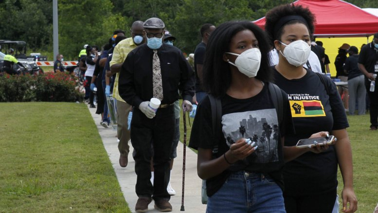 Texas county extends mask order amid record high COVID-19 cases