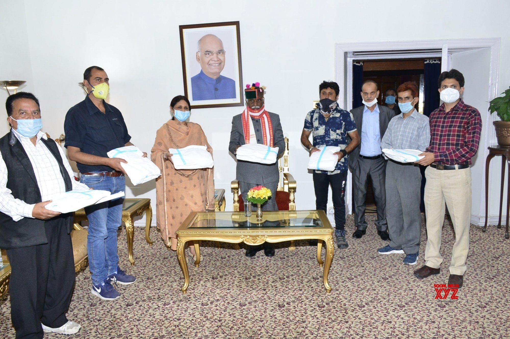 Shimla: Himachal Governor distributes PPE kits to barbers through State Red Cross Society #Gallery
