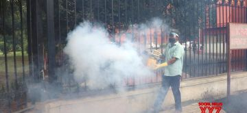Bengaluru: A municipal worker fumigates the premises of Karnataka High Court amid COVID-19 pandemic, in Bengaluru on June 30, 2020. (Photo: IANS)