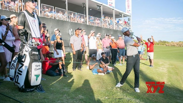 Finau cards 66 to lead at the Memorial; Woods starts well, but lies 18th
