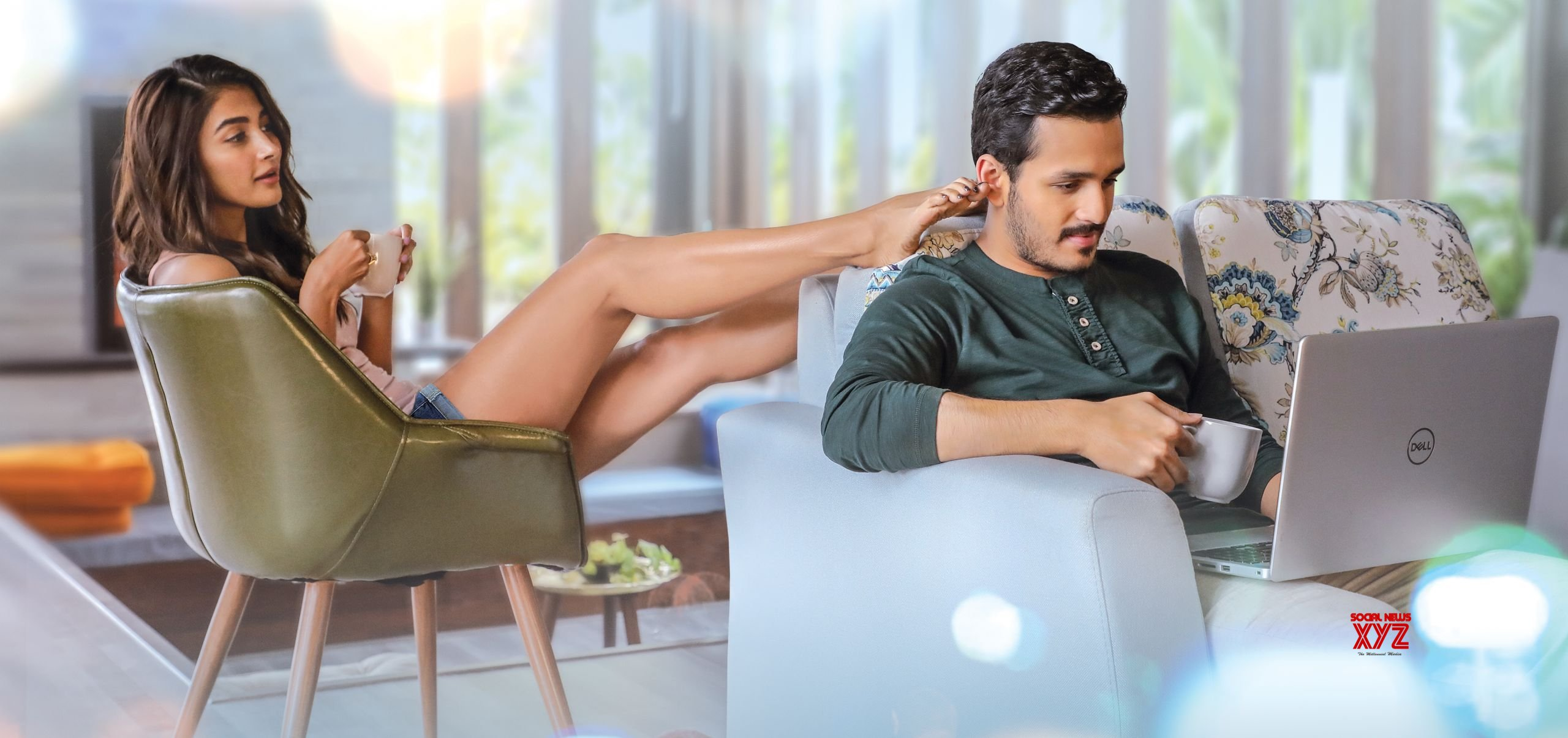 Romantic look poster of 'Most Eligible Bachelor' Starring Akhil Akkineni, and Pooja Hegde, and directed by  Bommarillu Bhaskar, produced by GA2 Pictures out now
