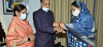 Shimla: Members of State BJP Mahila Morcha led by its President Rashmi Dhar Sood tie Rakhis on the wrist of Himachal Pradesh Chief Minister Jai Ram Thakur on the occasion of 'Raksha Bandhan' at his official residence 'Oak Over' in Shimla on Aug 3, 2020. (Photo: IANS)