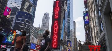 New York: People walk in Times Square in New York, the United States, on Aug. 9, 2020. (Xinhua/Wang Ying/IANS)
