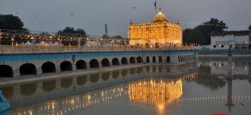 Amritsar: A view of the illuminated Durgiana Temple on the eve of Janmashtami celebrations in Amritsar on Aug 11, 2020. (Photo: IANS)