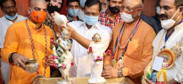 Delhi Chief Minister Arvind Kejriwal washes the idol of Lord Krishna with milk during Krishna Janmashtami celebrations at the ISKCON Temple in New Delhi on Aug 12, 2020. (Photo: IANS)
