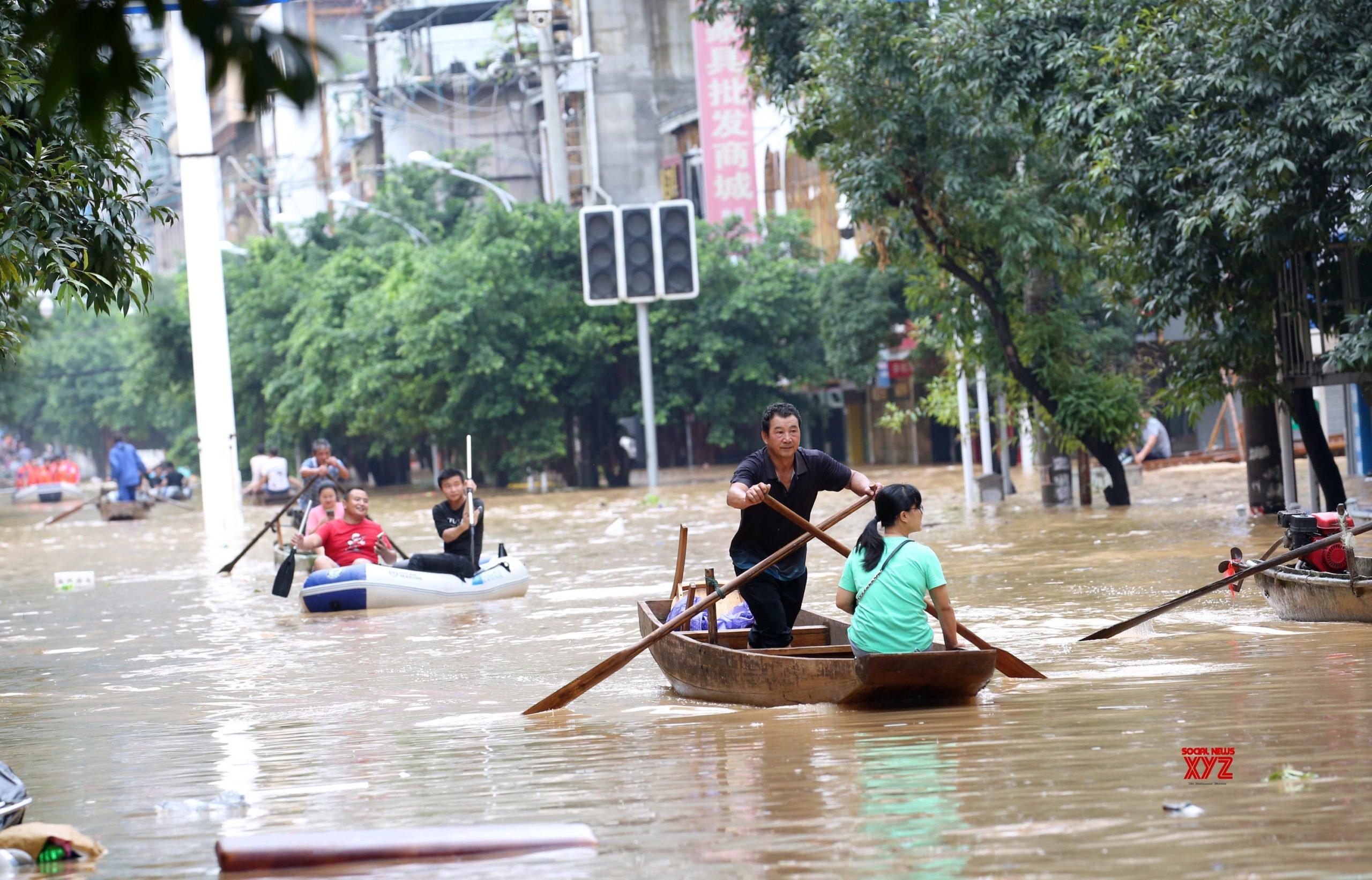 12 killed, thousands evacuated as floods ravage China