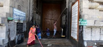 Chennai: Sanitation staff busy cleaning the temple premises after the Tamil Nadu Government permitted the reopening of the places of worship as part of several relaxations that shall apply to the extension of coronavirus-induced lockdown in the state till September 30, in Chennai on Aug 31, 2020. (Photo: IANS)