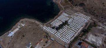 Lesbos, Sept. 14, 2020 (Xinhua) -- Aerial photo taken on Sept. 14, 2020 shows new tents for relocating migrants and refugees at Kara Tepe, Lesvos, Greece, after a fire broke out last Wednesday and destroyed the previous camp in Moria. (Photo by Panagiotis Balaskas/Xinhua/IANS)