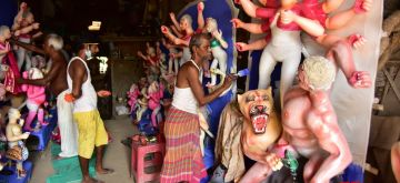 Guwahati: An artist gives finishing touches to an idol of Goddess Durga at a workshop ahead of Durga Puja celebrations, in Guwahati on Oct 16, 2020. (Photo: IANS)