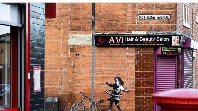Celebrated graffiti artist Banksy confirms UK hula-hooping girl mural is his work