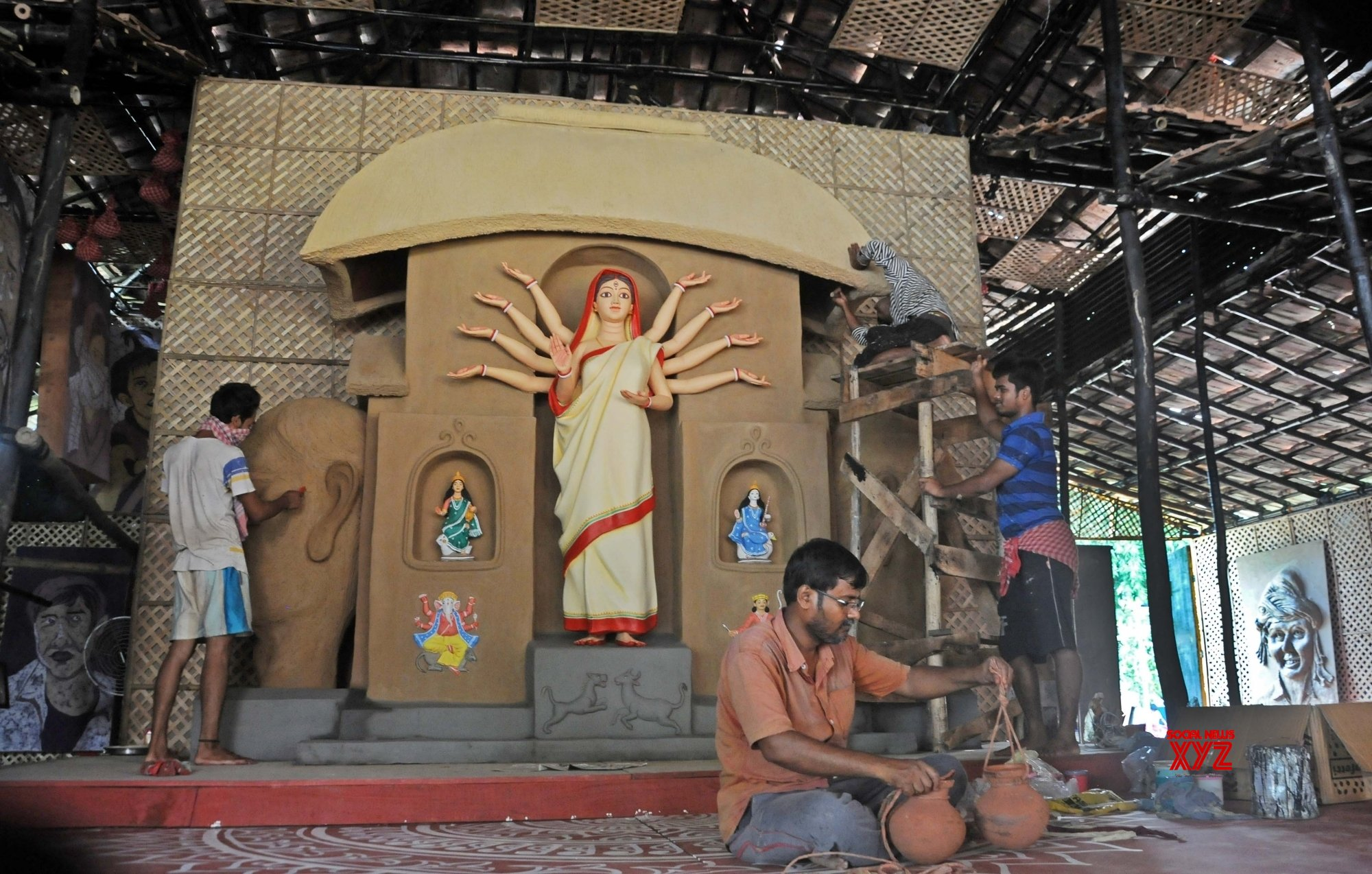 Kolkata: Puja Committee comes up with Durga Puja pandal on the theme of migrant laborers #Gallery