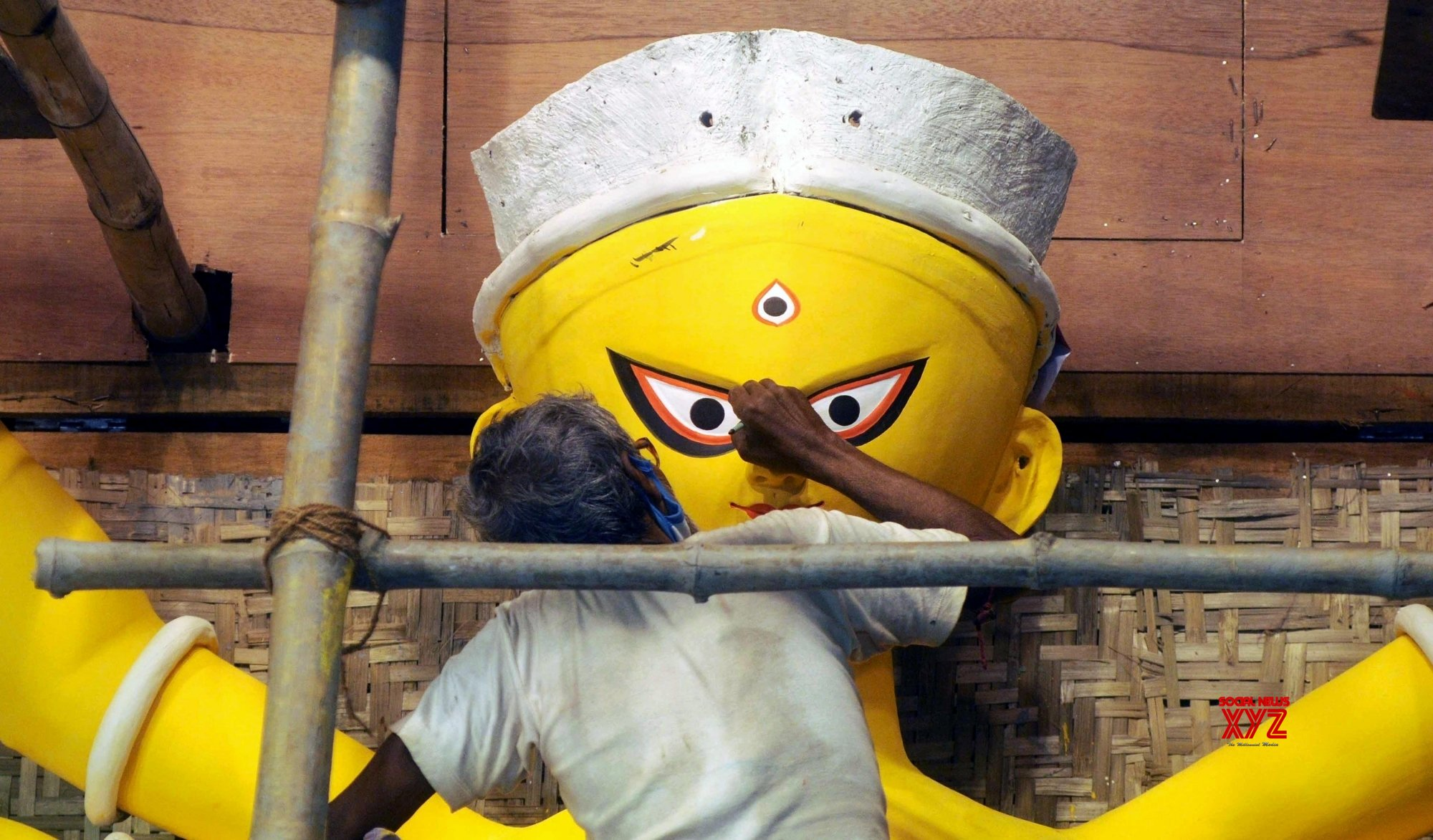 Kolkata: Artist gives finishing touches to an idol of Goddess Durga at the Baghbazar Sarbojanin #Gallery