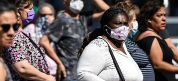 People wearing face masks are seen in Santiago, Chile, March 20, 2020. (Photo by Jorge Villegas/Xinhua/ians/)