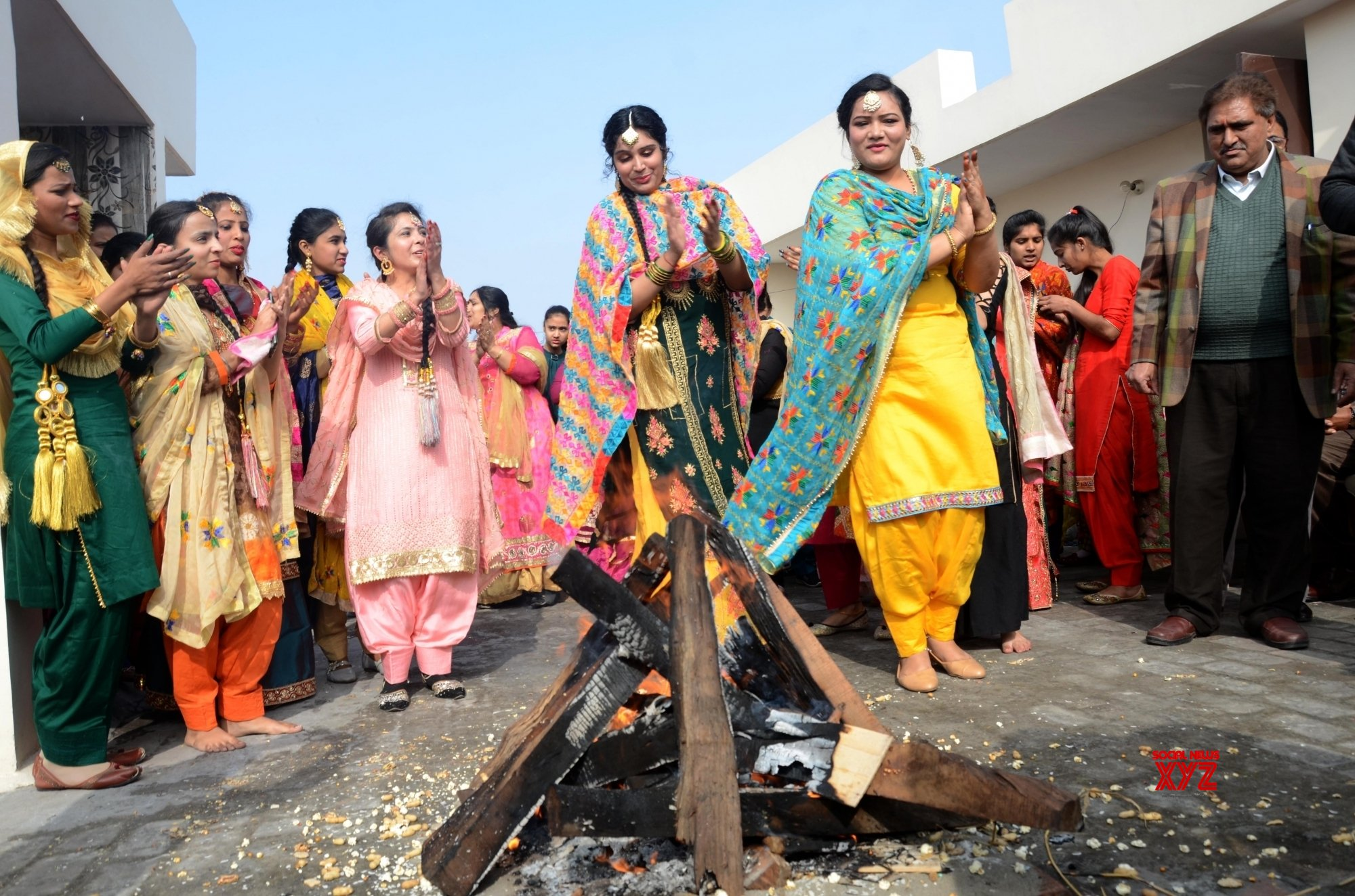 Amritsar: Students in traditional Punjabi dresses during the celebration of lohri on the eve of the Lohri festival #Gallery