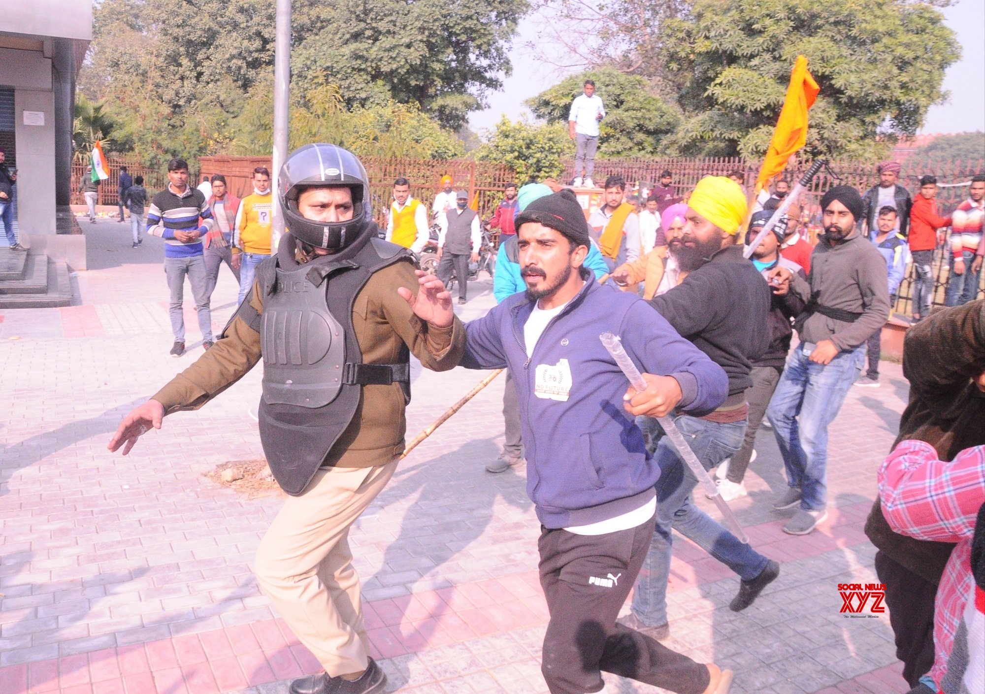 New Delhi: Police personnel being taken safely amidst violent clashes #Gallery